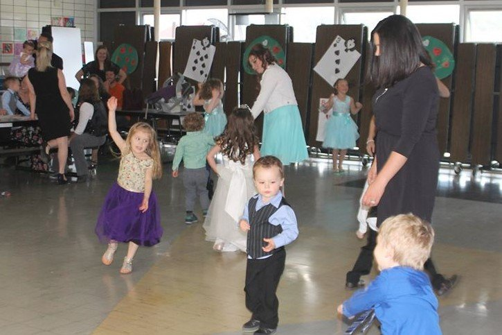 children and adults dancing